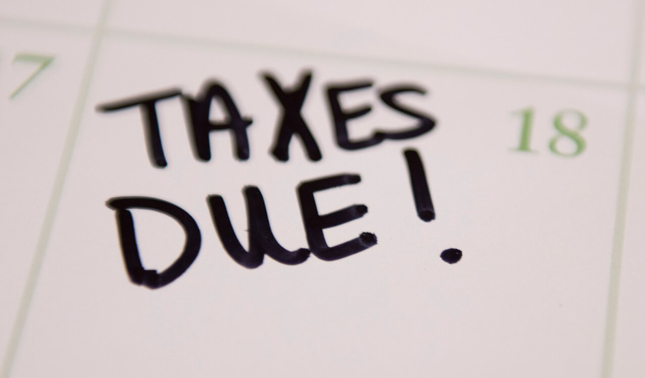 image of taxes due being written on a calendar