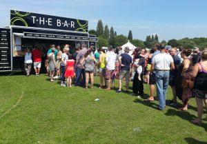 very long queue for the bar long eaten carnival