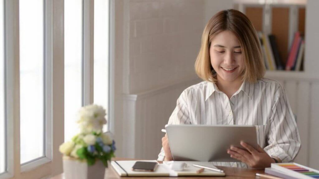 female professional working with an ipad