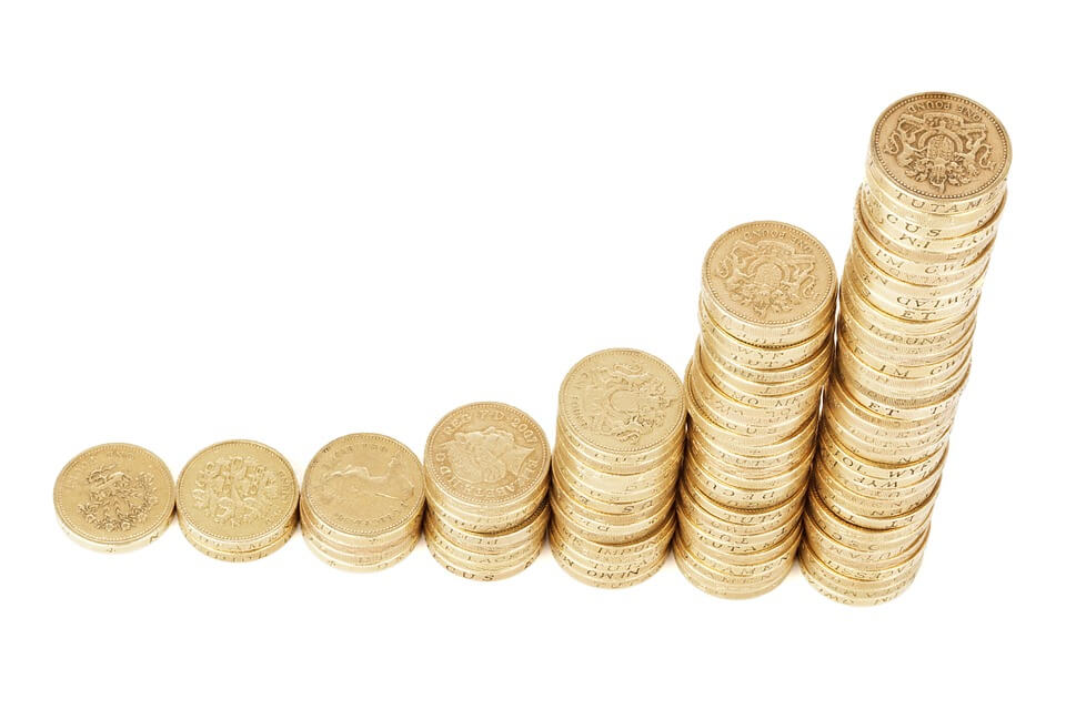 stack of pound coins increasing