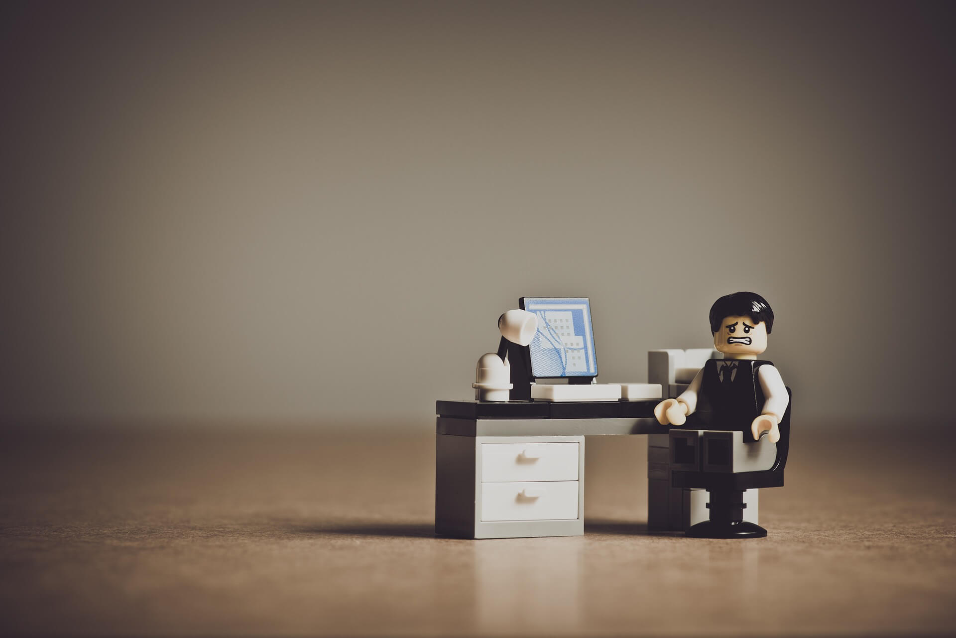 worried employer lego man about responsibilities