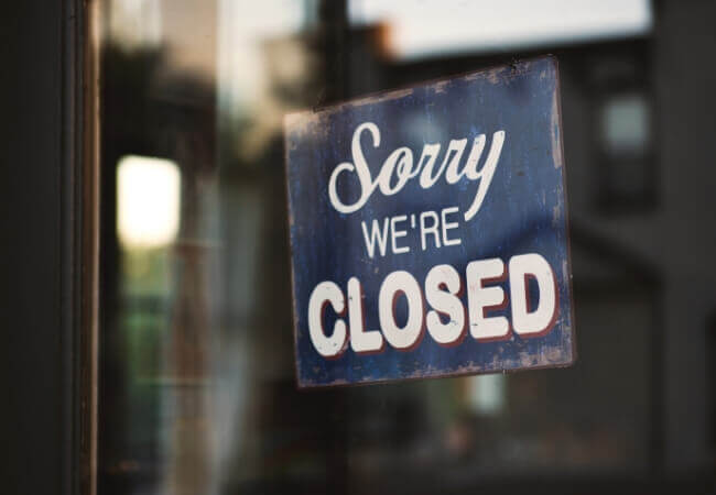 sorry were closed sign on a shop front