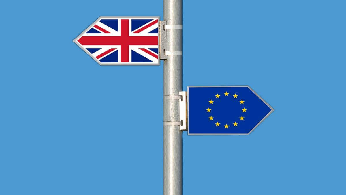 english and eu flag on metal pole